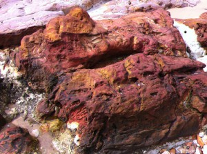 A red stone on Betka Beach, Mallacoota