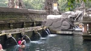Pura Tirta Empul locals and statue