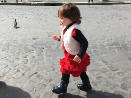 Little girl running on Piazza Navona, Rome