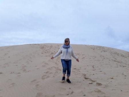 Climbing Rubjerg Knude fyr sand dunes