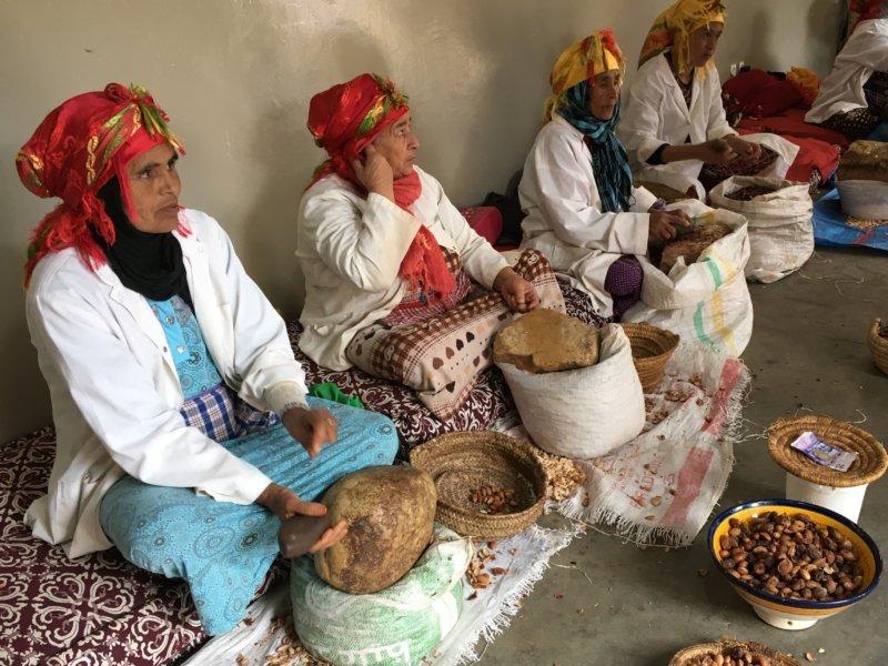 Moroccan women grinding argan seeds