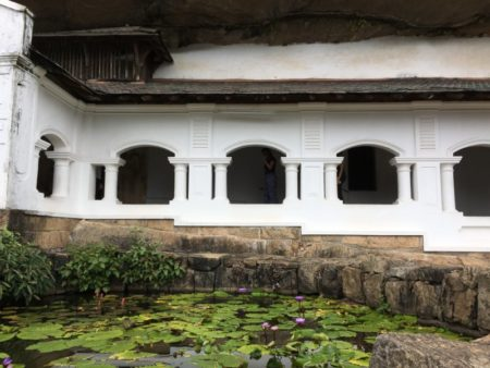 Dambulla Cave Temple and lotus pool