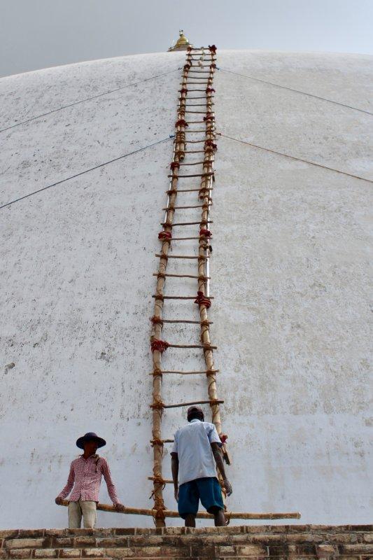 Repairing a stupa, Anuradhapura