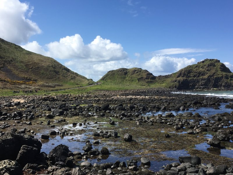 Giants Causeway stones and people walking