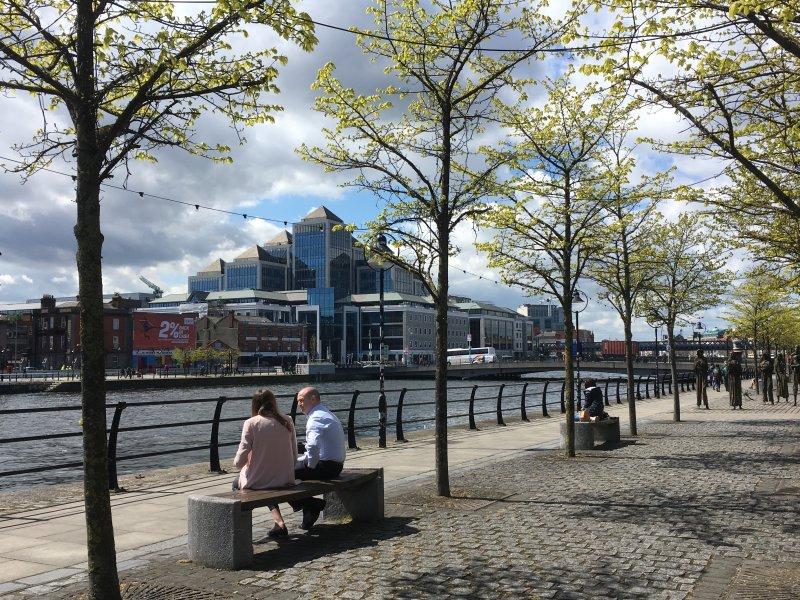 Sitting on Liffey river bank, Dublin