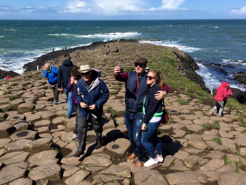 Tourists on Giants Causeway stone columns