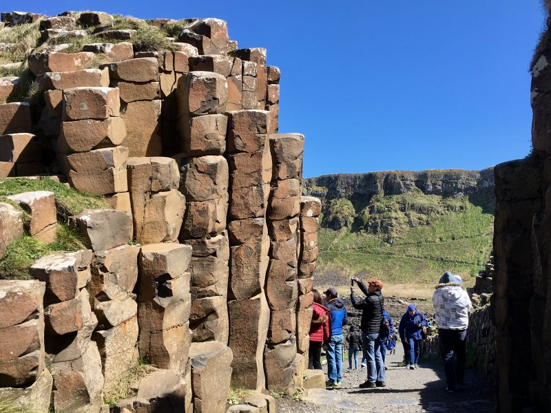 Tourists photographing Giants Causeway columns