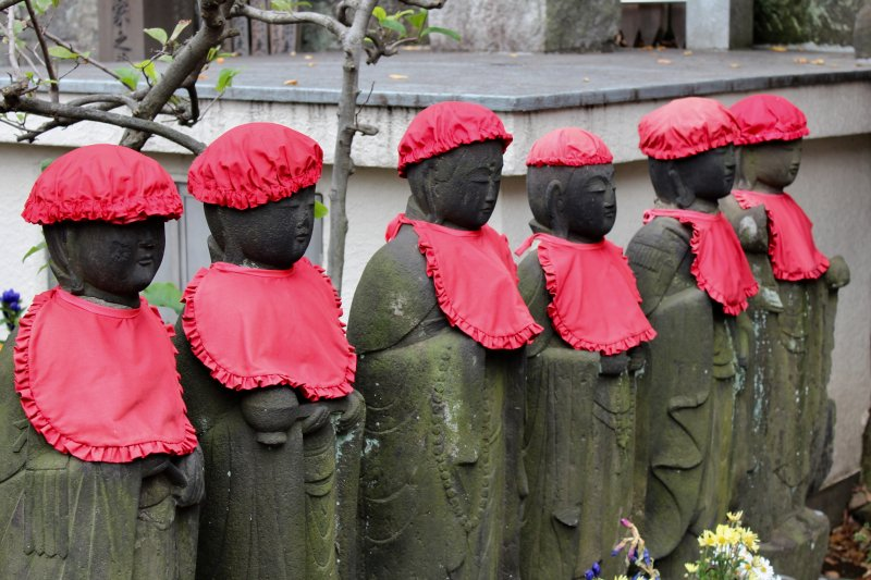 Japanese Ojizosama statues with hats and bibs