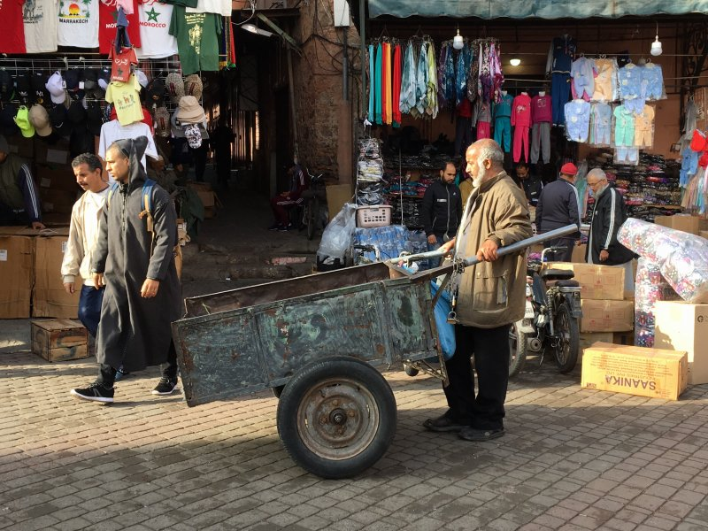 Man and his carriage in the souks of Marrakech