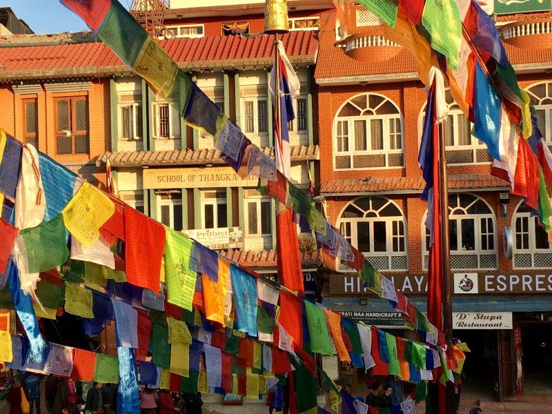 Boudanath Stupa prayer flags and surrounding townhouses