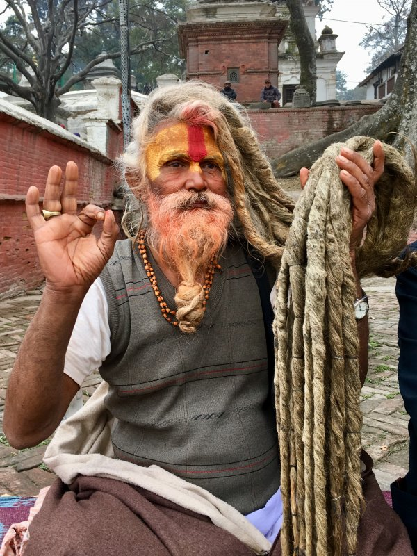 Holy man on Pashupatinath temple stairs