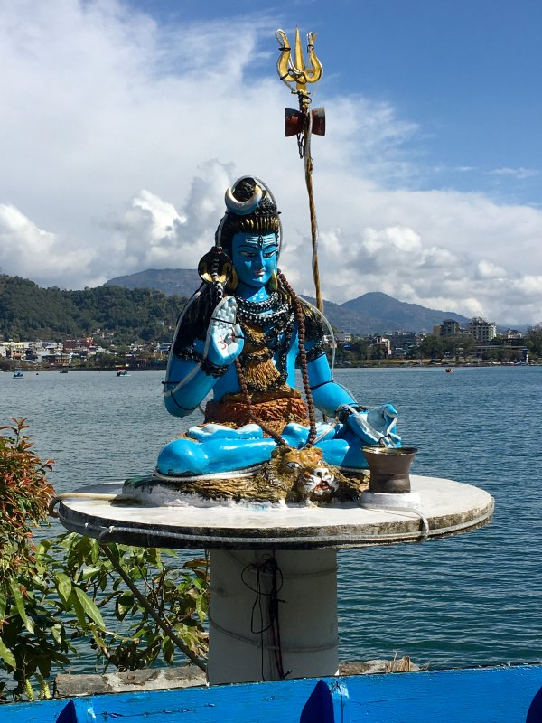 Blue statue behind the lake