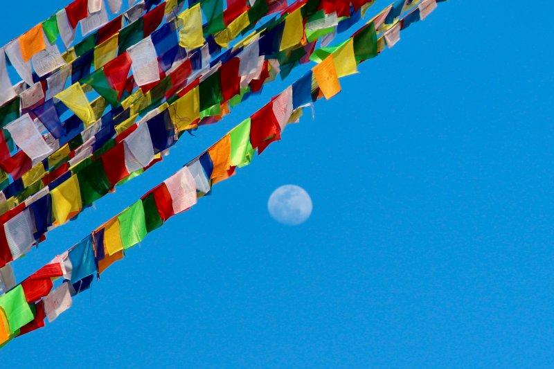 Prayer flags and full moon, Nepal