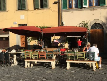 Italy by train and car: street cafe in Florence
